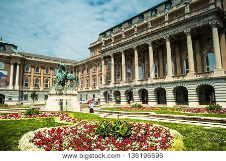 Budapest, Hungary - July 07, 2015: Buda castle courtyard with horse statue and lamps