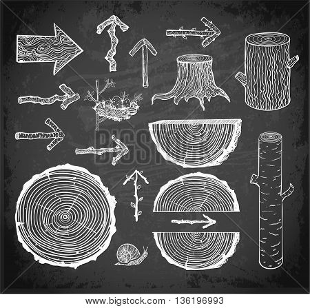 Sketches of wood cuts, logs, stump and wooden arrows on blackboard background.