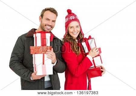 Young couple holding gifts on white background