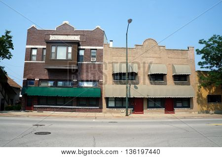 JOLIET, ILLINOIS / UNITED STATES - JUNE 30, 2015: Two historic brick buildings--one, the Simon Setina Building, constructed in 1916, and the other built in 1927--stand side by side in downtown Joliet.