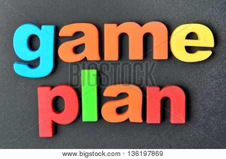 The words Game plan on black background closeup