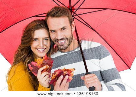 Happy young couple holding umbrella and maple leaves on white background