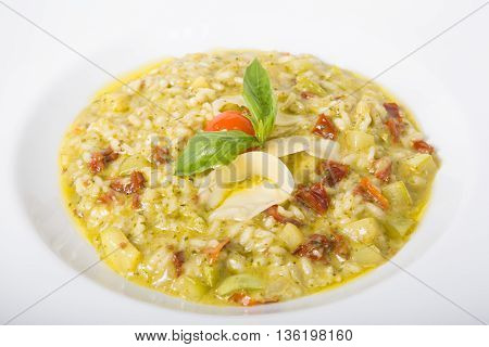 Italian risotto dish served with cheese and dried tomatoes