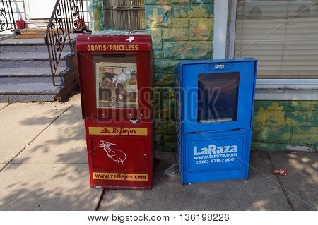 JOLIET, ILLINOIS / UNITED STATES - JUNE 30, 2015: Reflejos and La Raza are newspapers that are distributed free of charge through newspaper racks in Joliet.