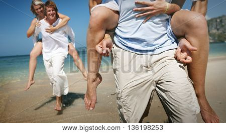 People Piggyback Beach Summer Holiday Vacation Concept