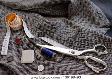 Collection of tailor tools on vintage classic jacket