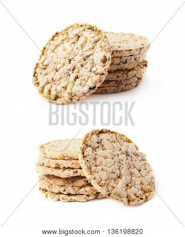 Pile stack of diet rice crackers isolated over the white background, set of two different foreshortenings