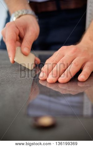 Tailor hands measuring a piece of fabric shallow depth of field focus