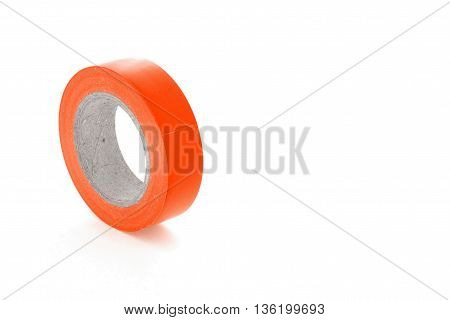 Protective adhesive orange insulation tape roll isolated on white background