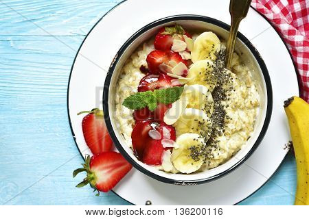 Oats Porridge With Banana,strawberry,chia Seeds And Chocolate Sauce.