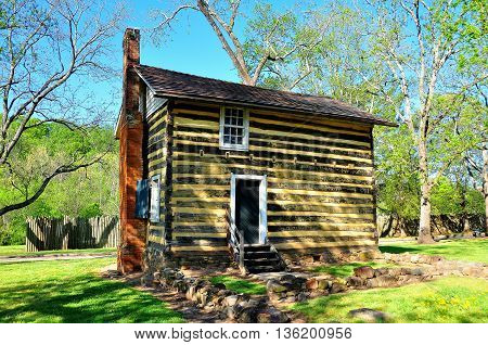 Bethabara North Carolina - April 23 2016: 18th century fachwerk cabin at the Bethabara Moravian settlement historic site - Xu Lei Photo