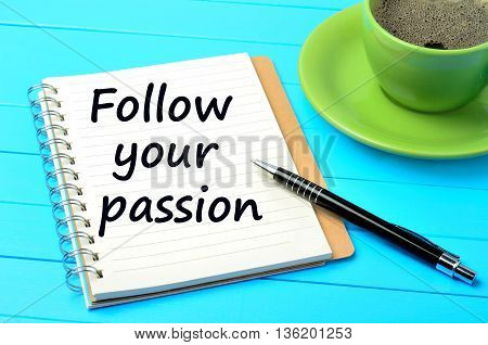 The words Follow your passion on notebook