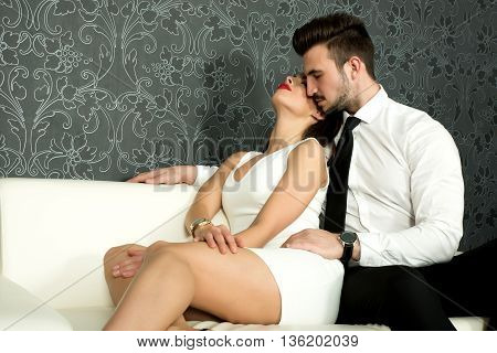 A young beautiful couple on the sofa.