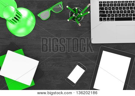 Office workplace set on wooden table. Pc, tablet, smartphone, notebook, green stationery, green glasses, cup of coffee, green lamp. 3d rendering.