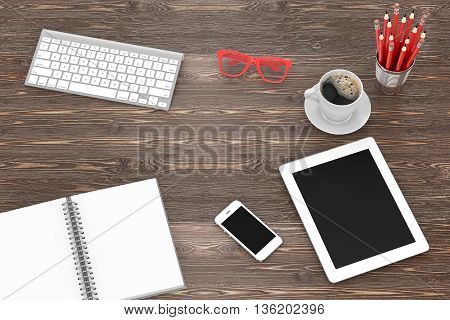 Office workplace set on wooden table. Pc, tablet, smartphone, notebook, red stationery, red glasses, cup of coffee, keyboard.3d rendering.