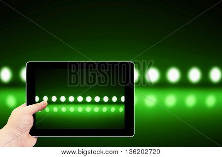 Tablet Photography Concept. Taking Pictures On A Tablet. Play Of Green Light On Defocusing Blur Led