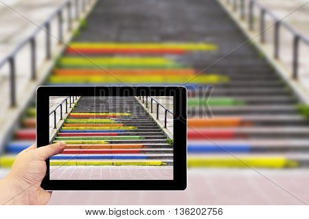 Tablet Photography Concept. Taking Pictures On A Tablet. Stairway In The Form Of Pencils Of Rainbow