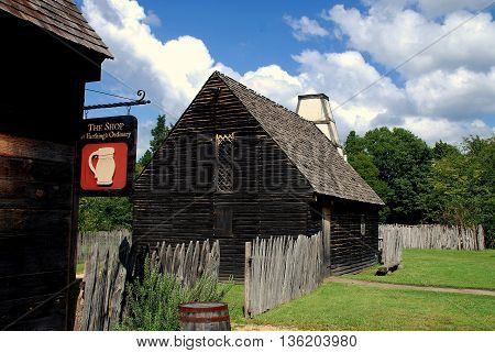 St. Mary's City Maryland - September 9 2011: 17th century wooden house with unique white chimney next to the Shop at Farthing's Ordinary