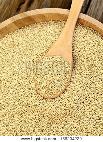 Amaranth seeds in bamboo bowl on table