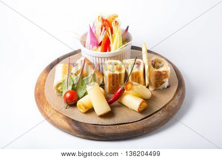 Wine cheese and vegetables snack on a wooden board