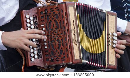 SELARGIUS, ITALY - September 8, 2013: Former marriage Selargino - Sardinia - Accordion buttons