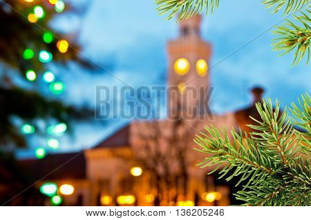 Christmas background with old town hall and christmas twig
