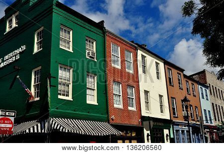 Baltimore Maryland - July 22 2013: A mix of 18th and 19th century buildings now house shops pubs and restaurants at historic Fells Point