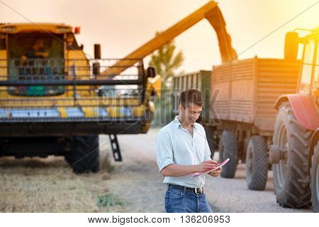 Farmer With Agricultural Machinery On Harvest