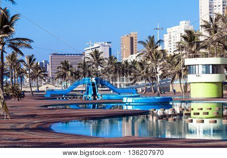 Blue Swimming Recreational Pool Area And Palm Trees