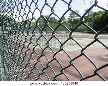 Chain Link Fence pattern with tennis court background