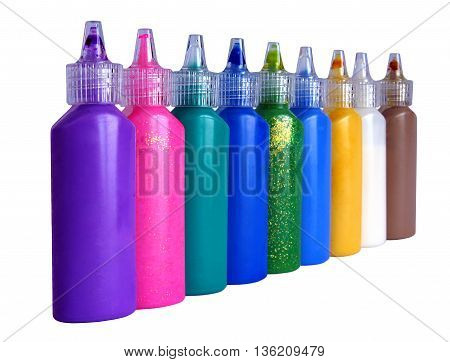 Tubes of paint isolated on a white background with shallow depth of field
