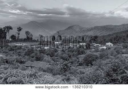 Beautiful view of Silerygaon Village with Kanchenjunga mountain range at the background morning light at Sikkim India. Black and white stock image.