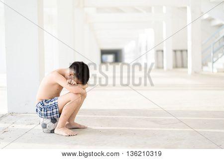 Boy Sit On Old Ball