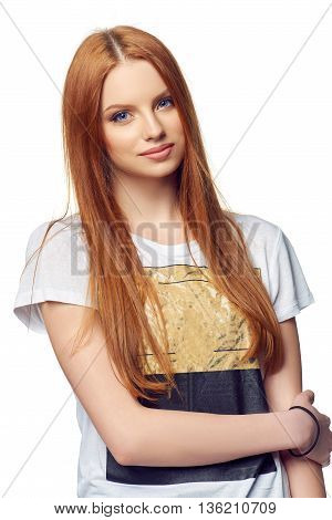 Portrait of attractive teenager girl smiling looking at camera, over white
