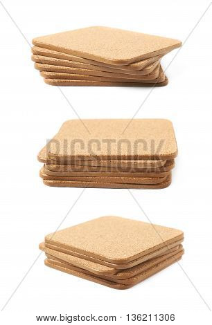 Pile of square cork textured drink's coasters isolated over the white background, set of multiple different foreshortenings