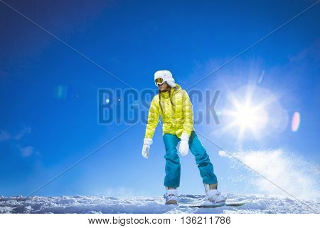 Active woman on a snowboard at winter
