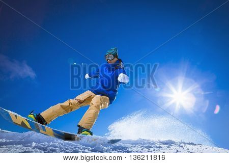 Active man on a snowboard at winter