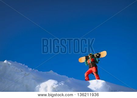 Young woman with snowboard on a mountain