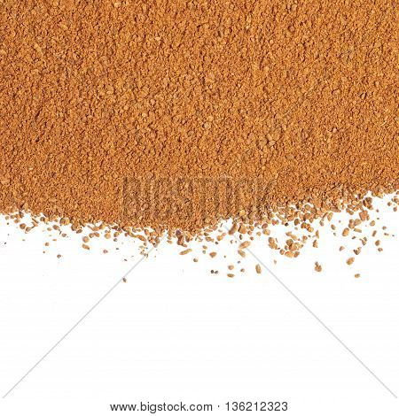 Surface covered with the cinnamon powder isolated over the white background as a backdrop composition