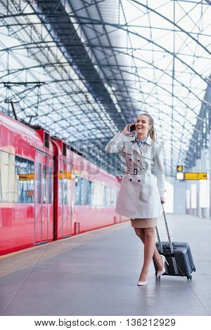 Smiling businesswoman with luggage