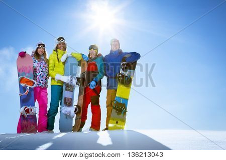 Smiling people with snowboards outdoors