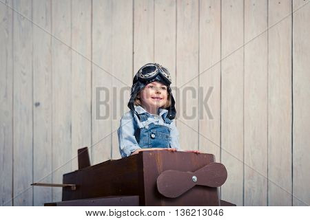 Smiling boy with plane in studio