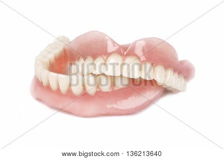 Close up medical denture on white background
