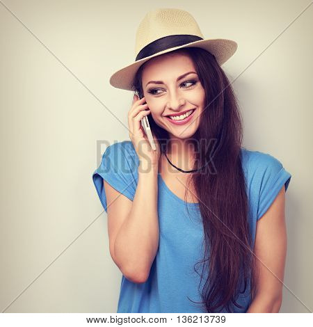 Happy Beautiful Casual Woman Talking On Mobile Phone In Summer Hat. Toned Color Portrait