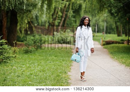 Stylish Black African American Girl Posing On Park With Turqoise Bag