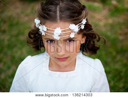Beautiful little girl on the head wreath of small flowers