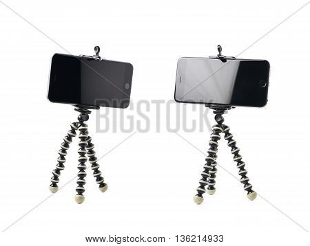 Smartphone set up on a tripod isolated over the white background, set of two different foreshortenings