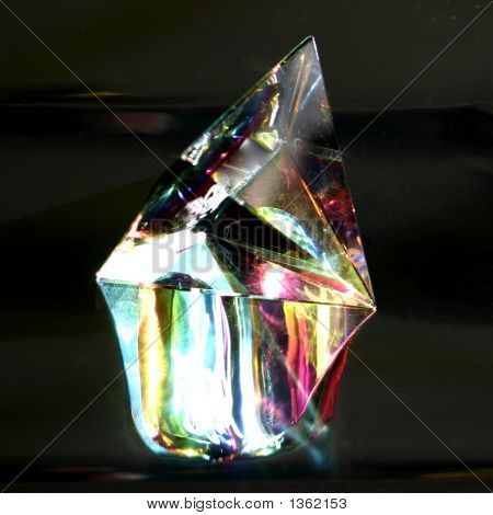Crystal Glass Prism Against A Dark Chrome Background