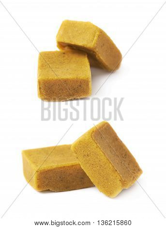 Two bouillon stock broth cubes, composition isolated over the white background, set of two different foreshortenings