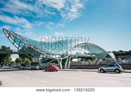 Tbilisi Georgia - May 19 2016: The Bridge of Peace is a bow-shaped pedestrian bridge over the Kura River in Tbilisi capital of Georgia.